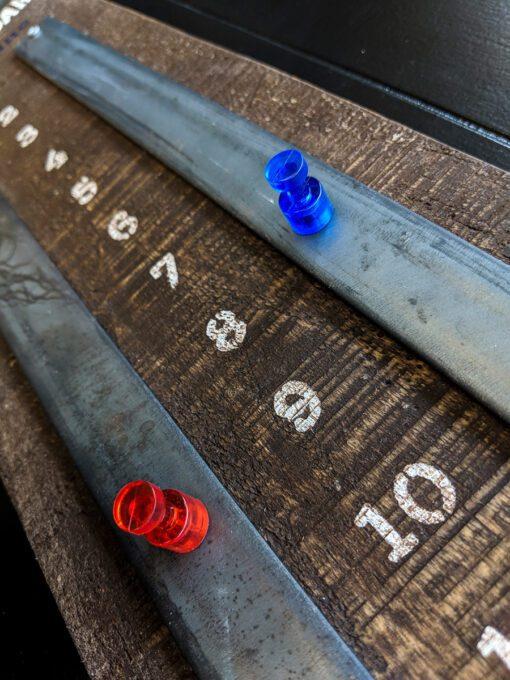 Detail of shuffleboard scoreboard scoring numbers