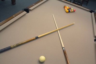 A pool table set and ready to be played